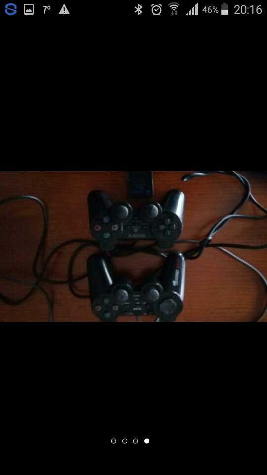 Imagen dos mandos una memori card y ps2