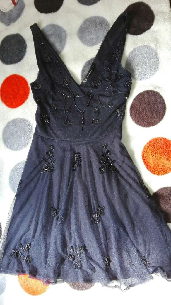 Imagen producto Vestido corto semi nuevo 1