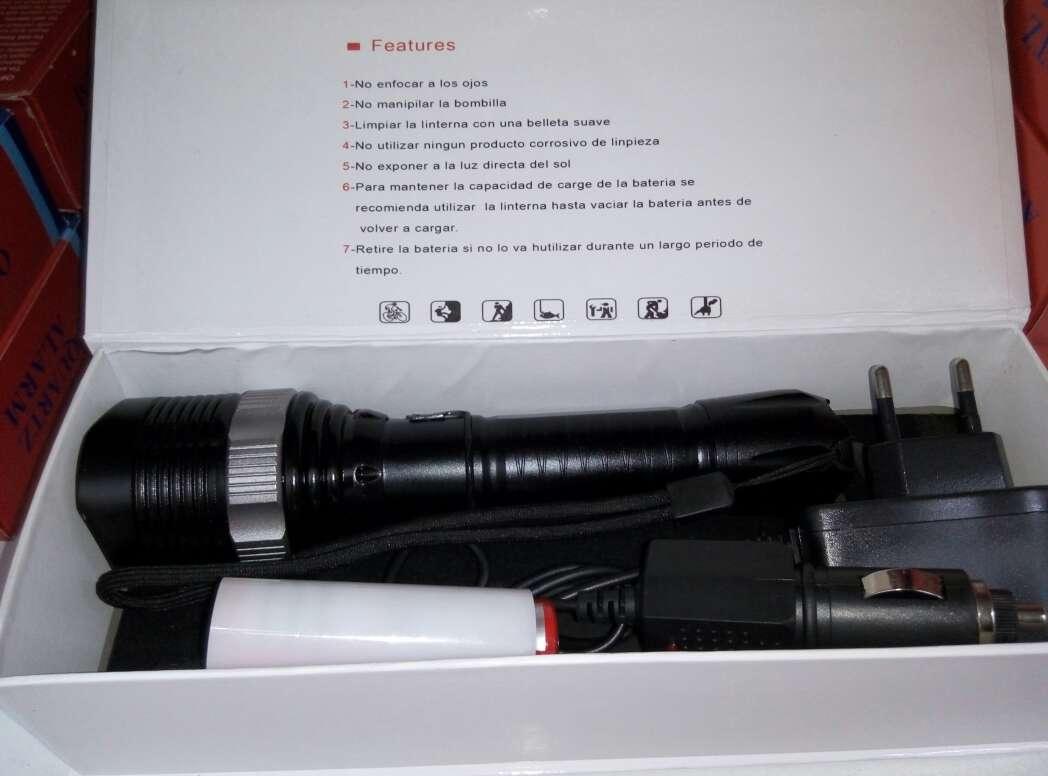 Imagen producto Linterna led bateria recargable nueva. 4