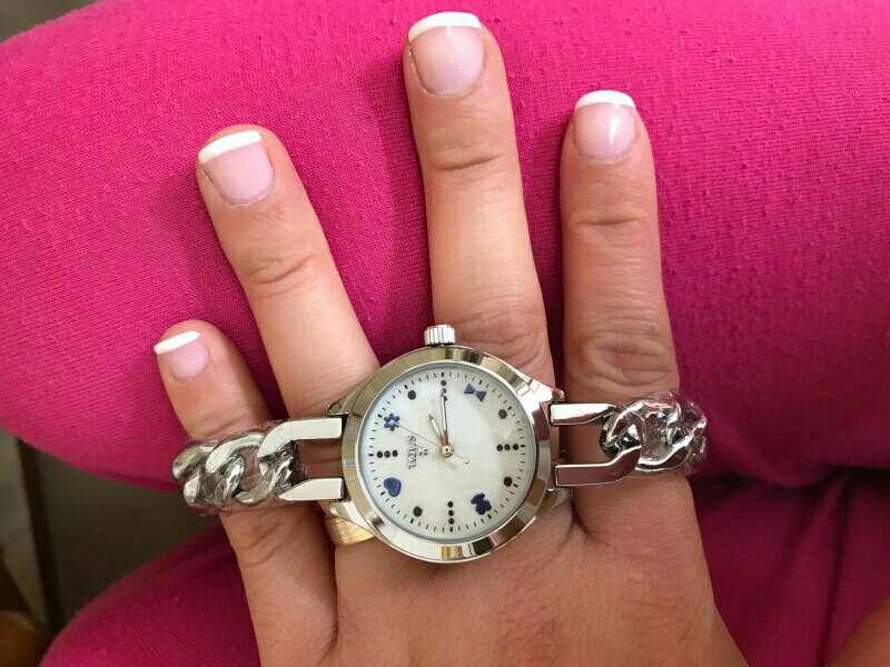 Imagen reloj oso mujer