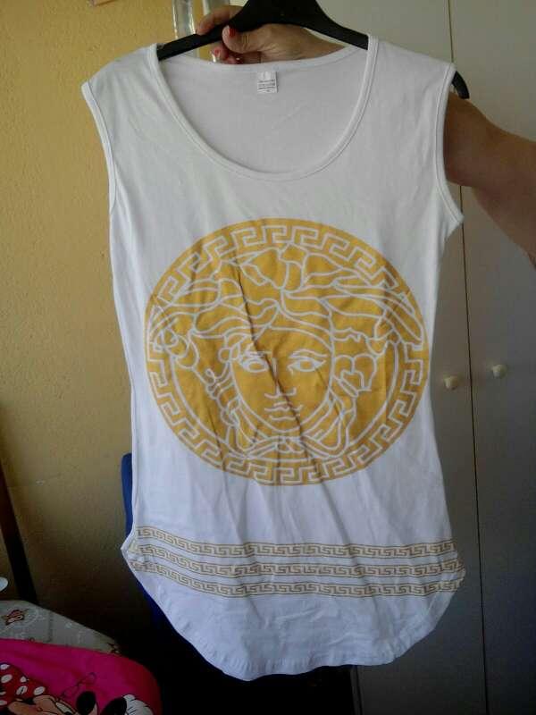 Imagen producto Camiseta blanca y dorada 2