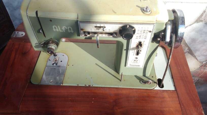 Imagen maquina de coser numéro de telefono 632614565
