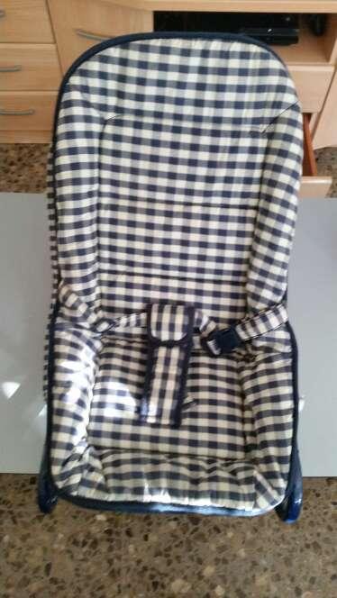 Imagen amaca de bebes con cinturon