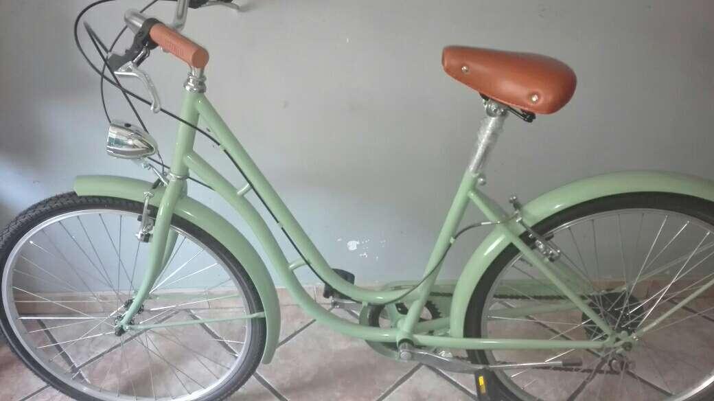 Imagen bicicleta verde pastel