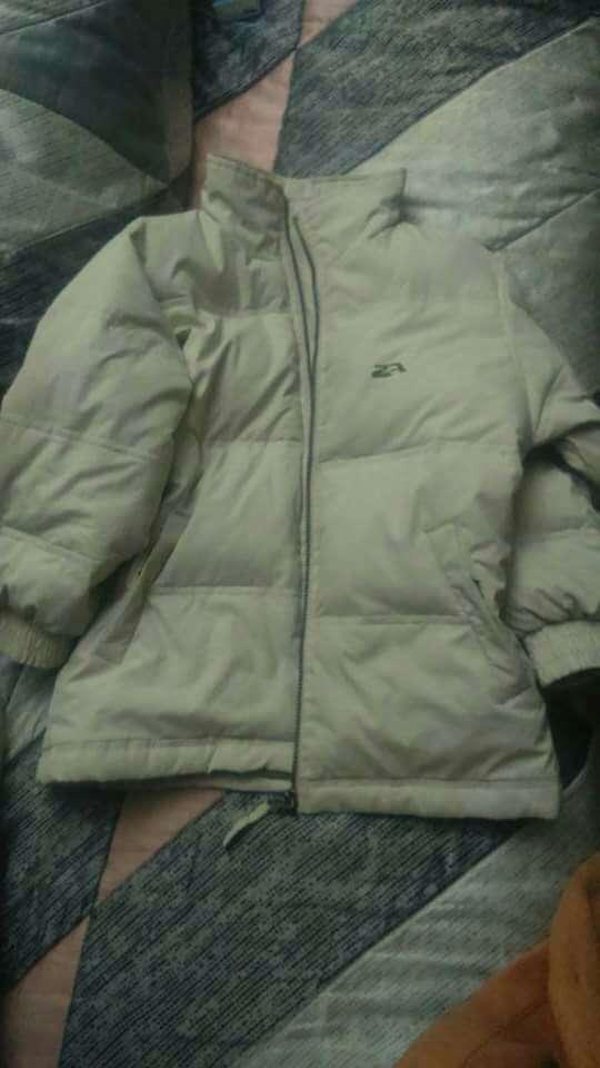 Imagen producto Abrigo blanco talla 6/8€ 1