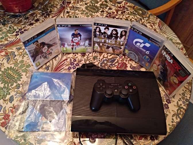 Imagen PS3 de 500gb con juegos y un mando