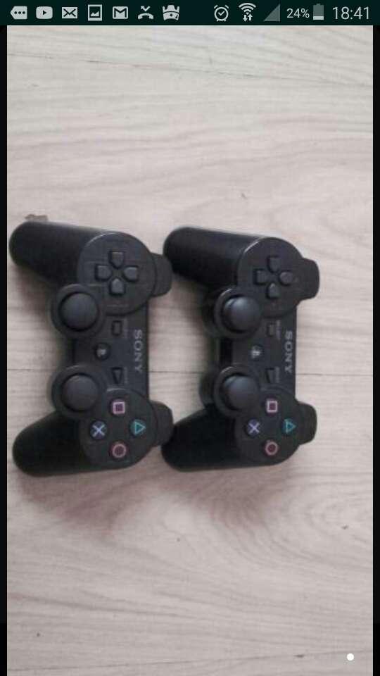 Imagen ps3 500 gb 2 mandos y 12 juegos