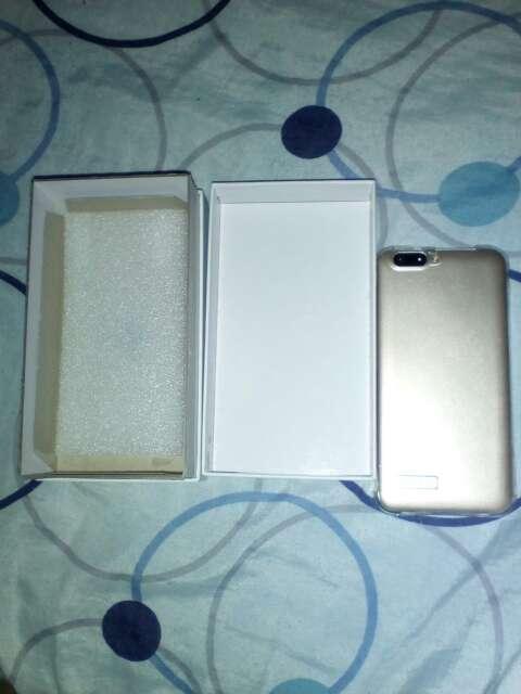 Imagen producto Telefono nuevo con su caja con auriculles  2
