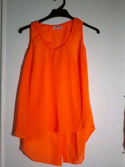 Imagen Top sin mangas naranja para mujer