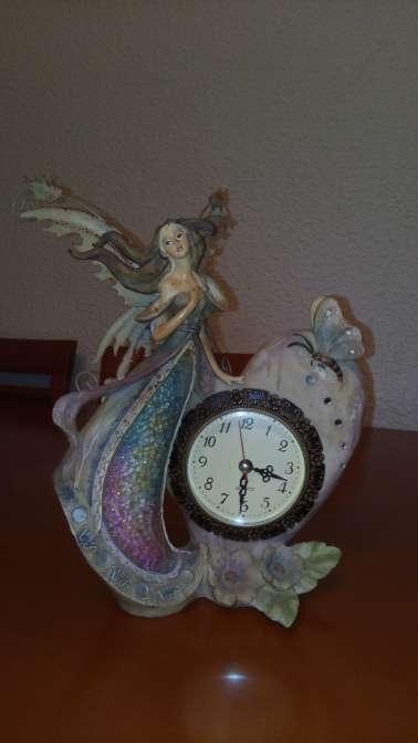 Imagen hada con reloj