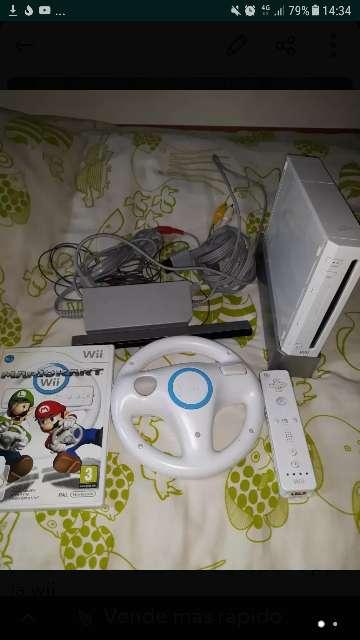 Imagen wii con Mario Kart y todos los accesorios