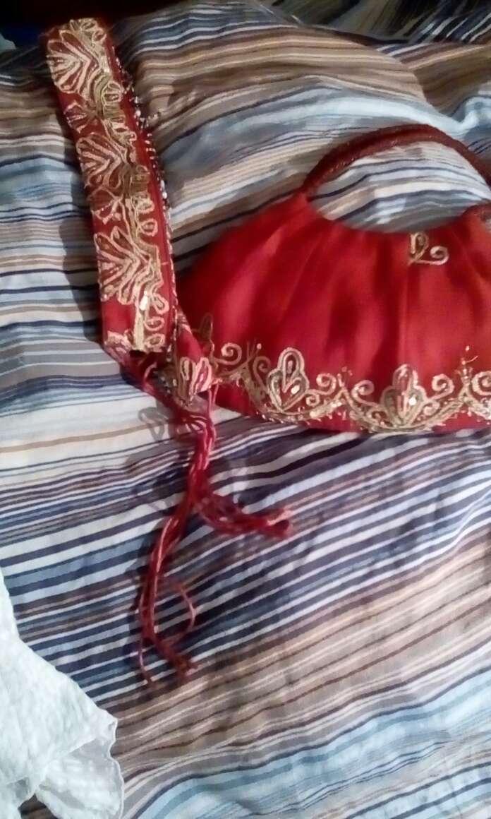 Imagen bolso y cinturón  bordado