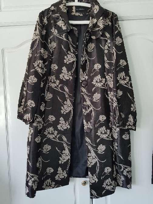 Imagen traje vestido y abrigo