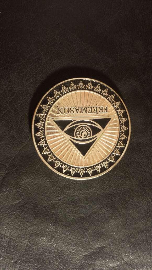 Imagen moneda masonería