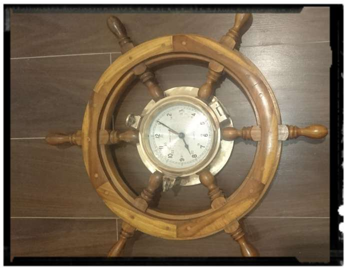 Imagen reloj Timon en cobre y madera.
