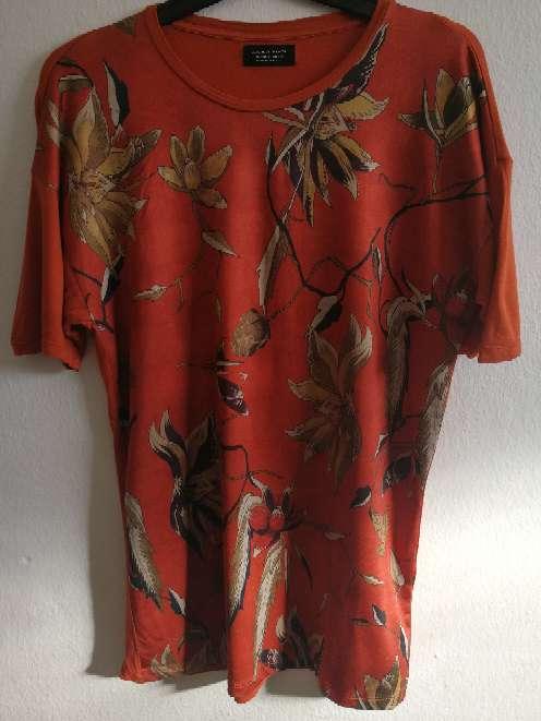Imagen camisa Zara en naranja