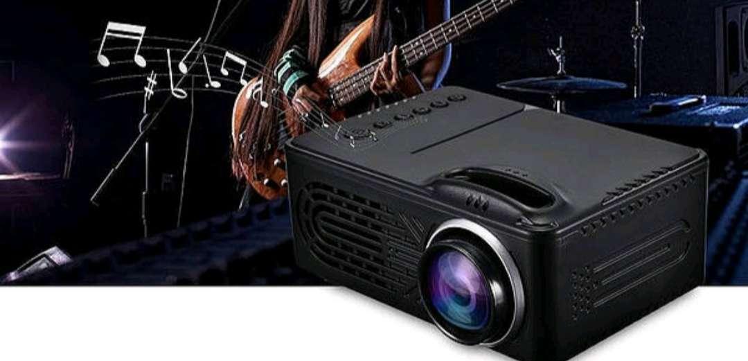 Imagen Mini proyector de películas, series, fotos y música