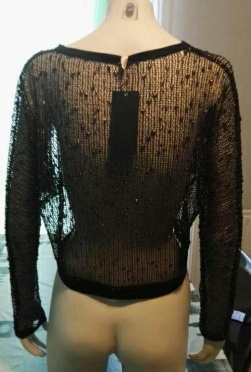 Imagen producto Camiseta rejilla talla única nueva 2