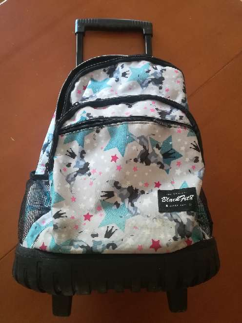 Imagen Carrito con mochila escolar