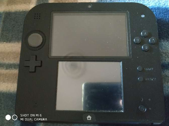 Imagen producto Nintendo 2ds con más de 10 juegos funda y cargador 3