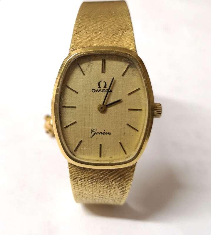Imagen reloj omega todo oro