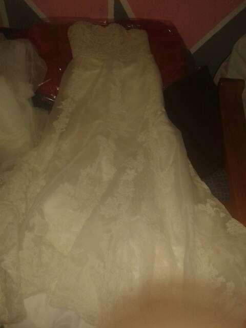Imagen traje de novia y velo