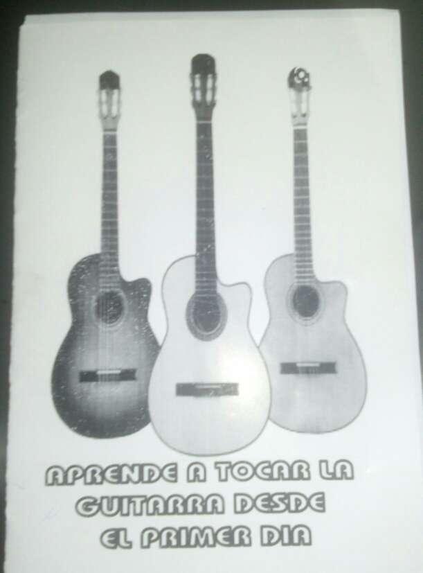 Imagen libro y cancionero para a ptender a tocar la guitarra .