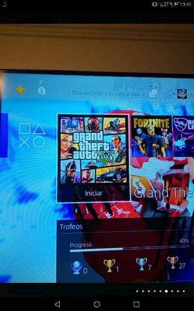 Imagen producto PS4 pro seminueva con mando, juegos y cables 6