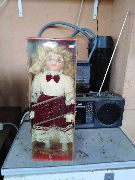 Imagen Munyeca en su caja
