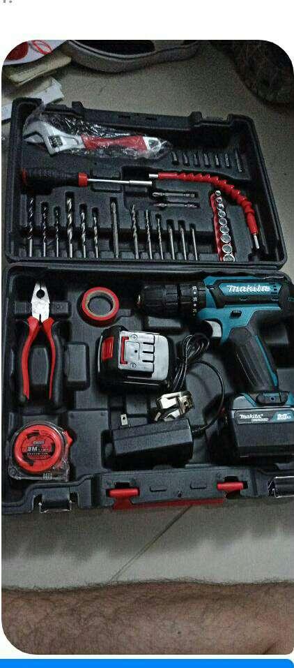 Imagen Taladro inalambrico percutor 24 voltios kit de herramientas,2 baterias,cargador y maleta
