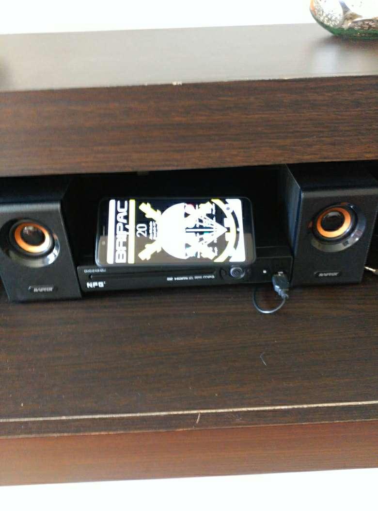 Imagen DVD, altavoces y xaomi remi note 5