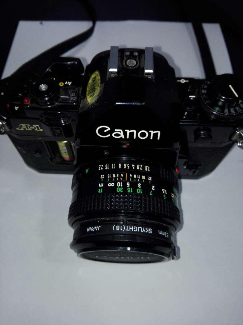 Imagen producto Camara canon con flash y objetivo incluyendo sus bolsas  6