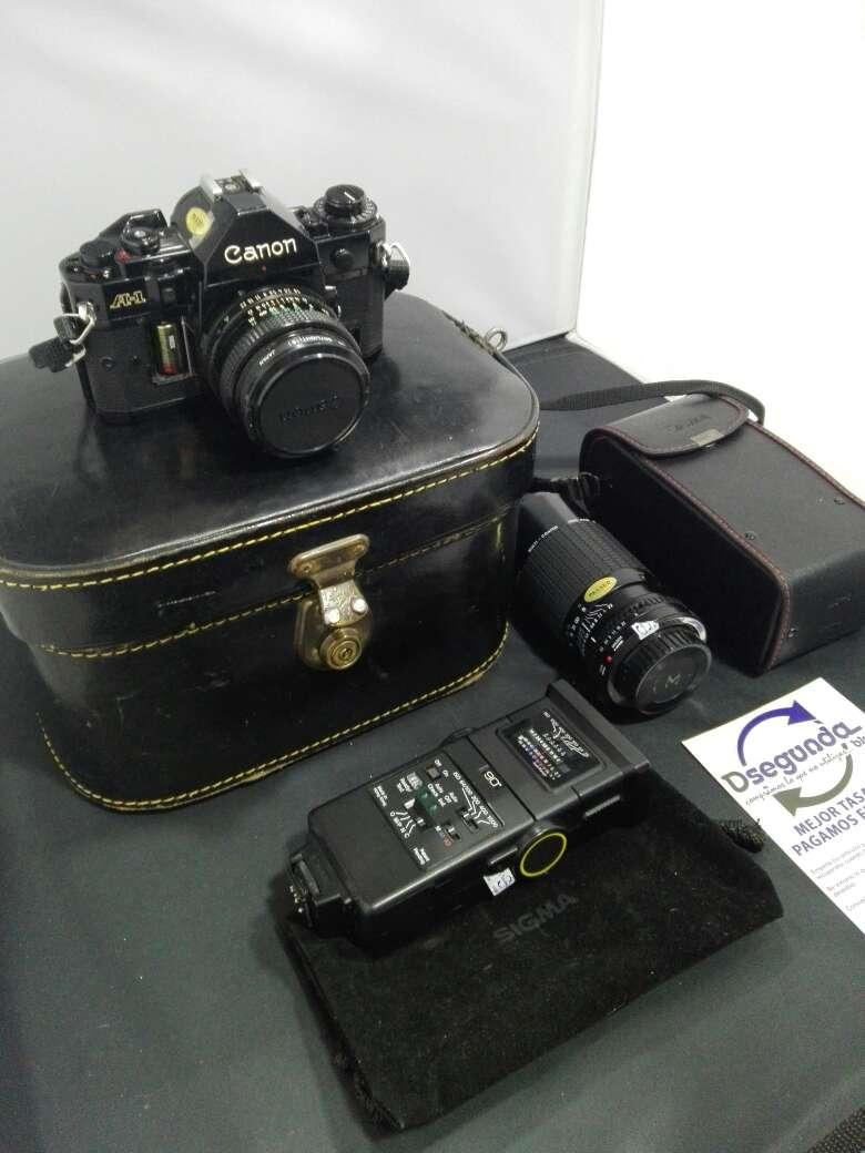 Imagen producto Camara canon con flash y objetivo incluyendo sus bolsas  2