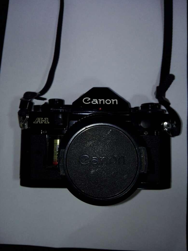 Imagen producto Camara canon con flash y objetivo incluyendo sus bolsas  5