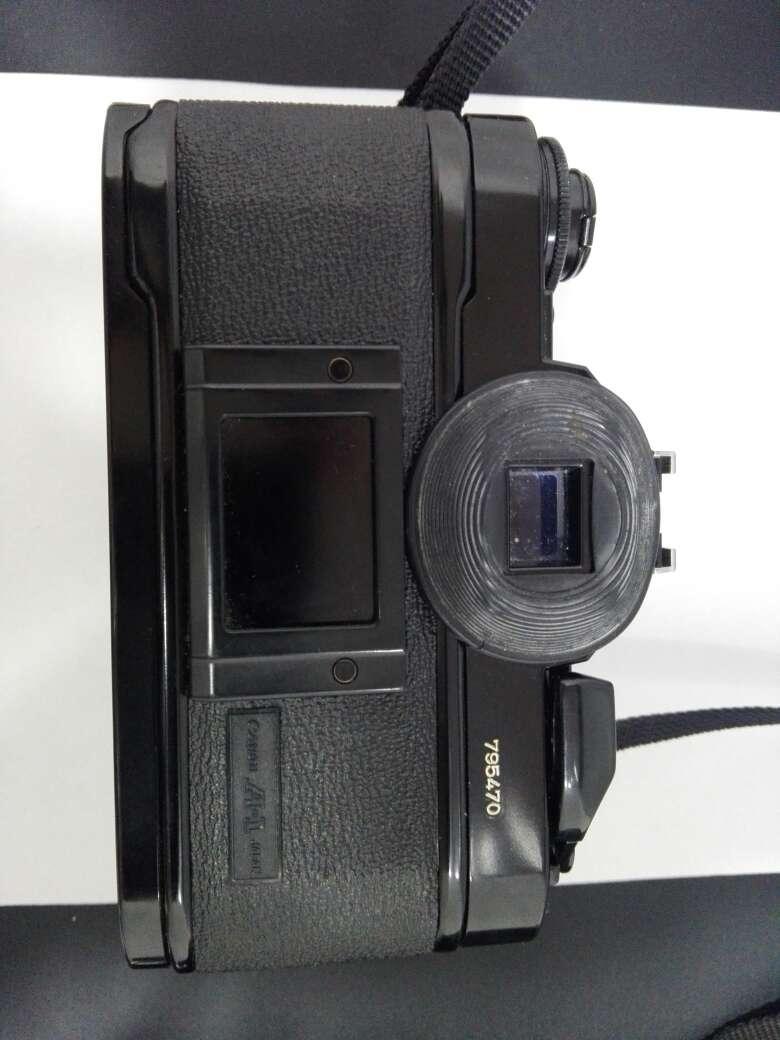 Imagen producto Camara canon con flash y objetivo incluyendo sus bolsas  7
