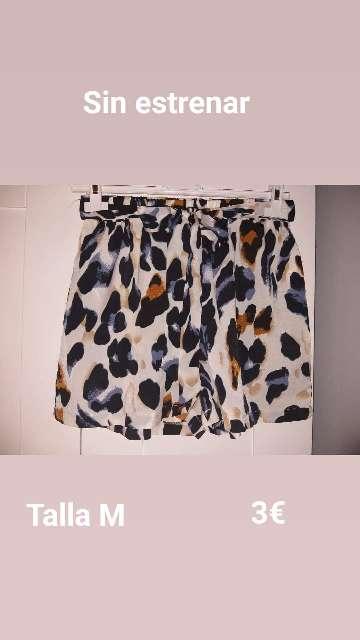 Imagen ropa a muy buen precio con poco o ningun uso .