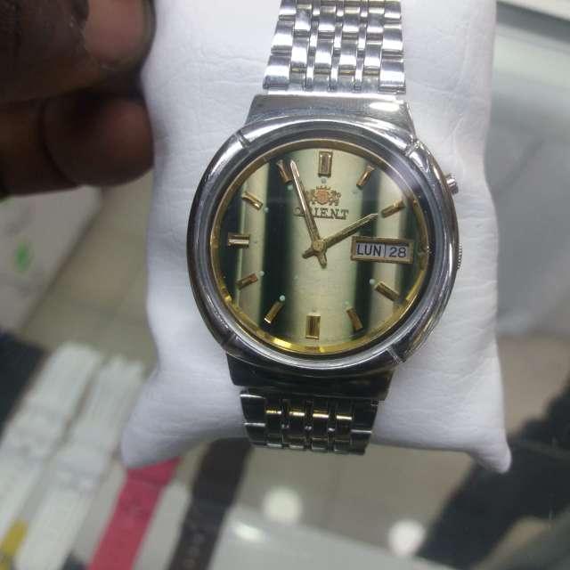 Imagen hermoso reloj marca orient automatico vendo. celular o watsapp 310-745-95-21