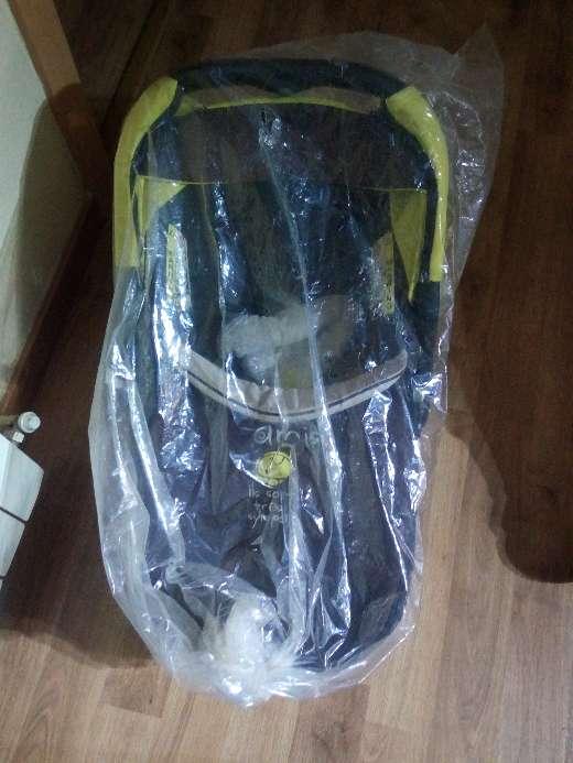Imagen cuco para llevar bebés en el coche