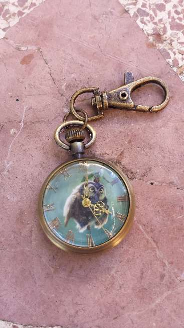 Imagen Reloj de bolsillo con colgante y buho en la esfera